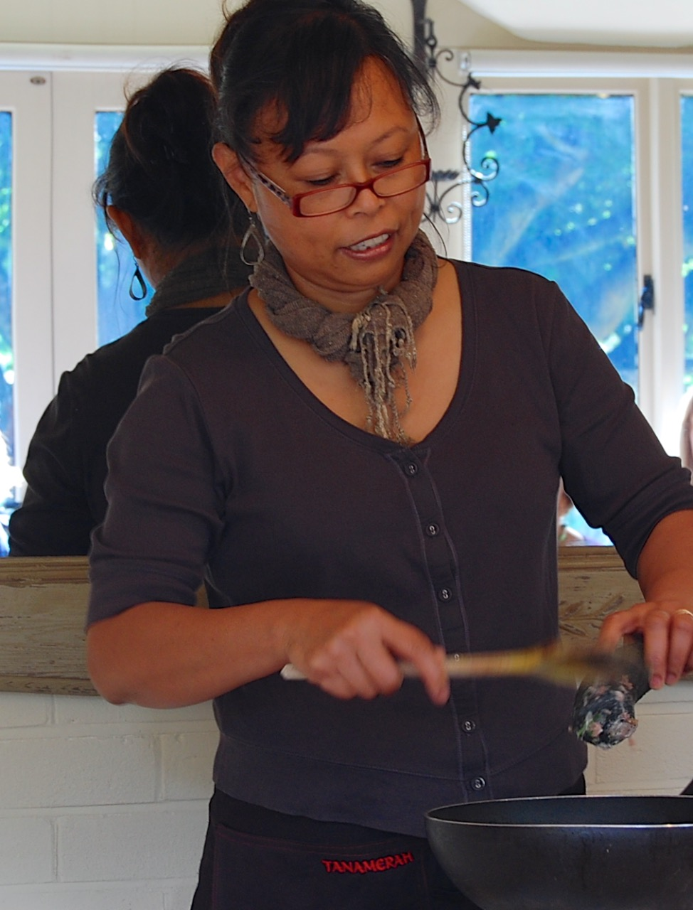Ina demonstrating Indonesian cooking